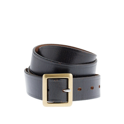 Embossed-edge belt with center bar buckle