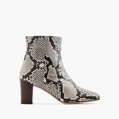 Heeled ankle boots in snakeskin-printed leather